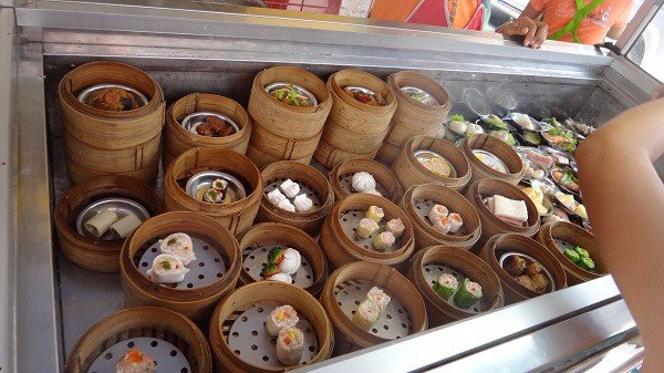 Choosing-from-the-many-steamers-of-Dim-Sum-on-offer.